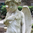 Angel statue with cross — Stock Photo