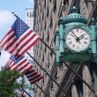 Marshall Field's clock and American Flags - Stock Photo