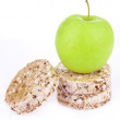 Dietetic loaves from bran and germ of wheat with green apple — Stock Photo