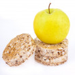 Dietetic loaves from bran and germ of wheat with green apple — Stock Photo #7245855