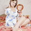Beautiful woman with a mirror in the bedroom — Stock Photo