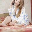 Стоковое фото: Beautiful woman lying in the bedroom