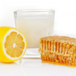 Stock Photo: Milk with honey and lemon