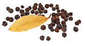 Black pepper and bay leaf — Stock Photo