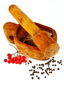 Rowan berries with a mortar and peppercorn — Stock Photo