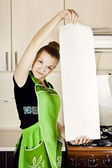 Young woman cooks dinner in the kitchen — Foto de Stock