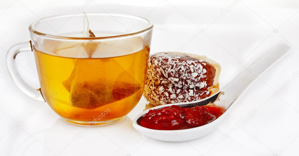 Tea with strawberry jam and biscuits with nuts  Stock Photo #7797965