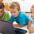 Focused kids looking at laptop computer — Stock Photo #6784254