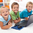 Happy healthy kids with laptop computer - Stock Photo