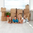 Happy woman and kids in their new home — Stock Photo #6784259