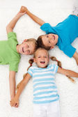 Happy laughing kids on the floor — Stock Photo