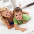 Happy mother and son playing in the living room — Stock Photo #7113467