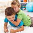 Stockfoto: Kids wrestling on floor