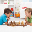 Two boys playing chess — Stock Photo #7113498