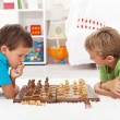 Kids playing chess - Stock Photo
