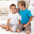 Two friends in the kids room - Stock Photo