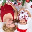 Royalty-Free Stock Photo: Woman and little girl under the christmas tree