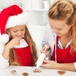 Stock Photo: Decorating the gingerbread cookies