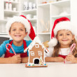 Happy kids at christmas time in the kitchen — Stock Photo
