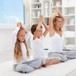 Balanced life - woman with kids doing yoga — Stock Photo