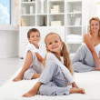 Kids and woman doing stretching exercises — Stock Photo