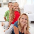 Family quality time - woman with kids — Stock Photo