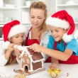 Happy family at christmas time in the kitchen — Stock Photo