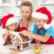 Happy family at christmas time in the kitchen — Stock Photo #7113668