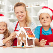 Happy christmas family in the kitchen — Stock Photo