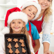 Happy family baking gingerbread cookies — Stock Photo