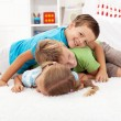 Happy wrestling kids in a pile — Stock Photo