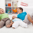 Happy kids playing on the floor — Stock Photo #7113696