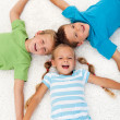 Happy laughing kids on the floor — Stock Photo #7113698