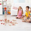 Kids playing with bow and arrow at home — Stock Photo