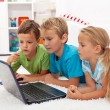 Stock Photo: Kids found something interesting on laptop computer