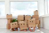 Family having fun with cardboard boxes — Foto de Stock