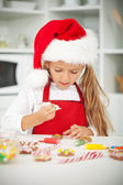 Little girl at christmas time in the kitchen — Stock Photo