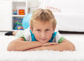 Beautiful kid resting on the floor — Stock Photo