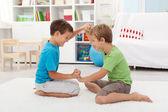 Kids wrestling on the floor — Stock Photo
