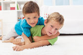 Kids wrestling on the floor - boys game — Stock Photo
