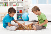 Kids playing chess in their room — Stock Photo