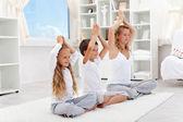 Balanced life - woman with kids doing yoga — Stock Photo
