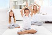 Happy balanced life - doing yoga exercise — Stock Photo