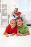 Kids laying on the floor in the living room — Foto Stock