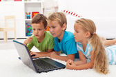 Kids found something interesting on laptop computer — Stock Photo
