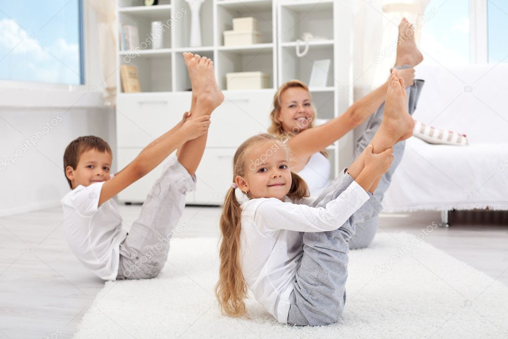 Healthy morning stretching - woman with kids doing gymnastic exercise at home — Stock Photo #7113621