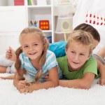 Happy kids on the floor — Stock Photo