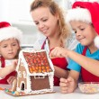 Preparing a gingerbread cookie house — Stock Photo