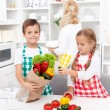 Kids unpacking groceries in the kitchen — Stock Photo