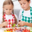 Stock Photo: Kids preparing veggies on stick